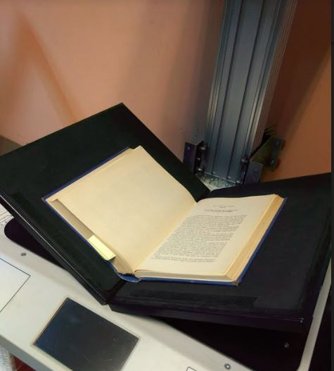 Book Scanning Services Review - Scanning a book on our high quality book scanner