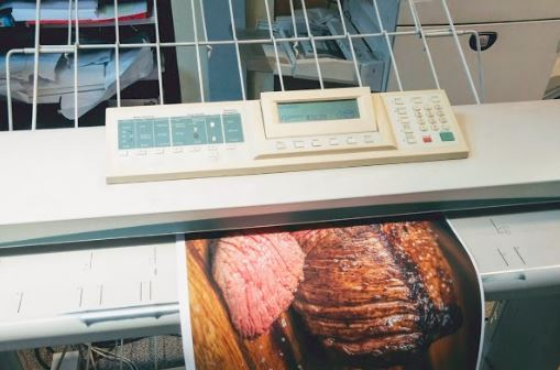How to scan large documents - Picture of an A2 poster being scanned